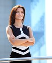Casual business woman with arms crossed and smiling Royalty Free Stock Photo