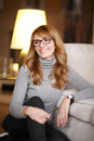 Casual business woman portrait of confident sitting at home in living room shallow focus Stock Photo