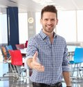 Casual businessman offering hand in meeting room happy at office Royalty Free Stock Photo