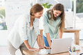 Casual businesswomen working with laptop in the office Royalty Free Stock Images