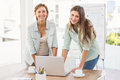 Casual businesswomen working with laptop portrait of Stock Photos