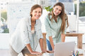 Casual businesswomen working with laptop portrait of Royalty Free Stock Images