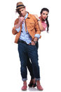 Casual couple with woman standing behind man full length picture of a young the women the men while holding him over his shoulders Royalty Free Stock Images