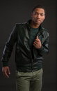 Casual dressed young african american male fashion model natural looking on grey background Stock Photography