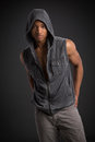 Casual dressed young african american male fashion model natural looking on grey background Stock Image