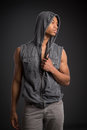 Casual dressed young african american male fashion model natural looking on grey background Stock Photos