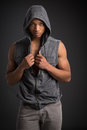 Casual dressed young african american male fashion model natural looking on grey background Royalty Free Stock Image