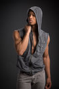 Casual dressed young african american male fashion model natural looking on grey background Royalty Free Stock Photography