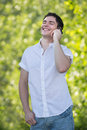 Casual Dressed Young Man Laugh Loud  on Cell Phone Royalty Free Stock Image