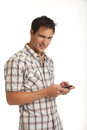Casual dressed young student texting on cell phone isolated white background Stock Photos
