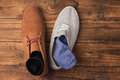 Casual and dressy mens shoes on wooden table Stock Photo