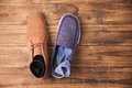 Casual and dressy mens shoes on wooden table Stock Images