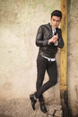 Casual fashion man leaning on a old pipe Royalty Free Stock Photo