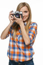 Casual female shooting with retro camera Stock Photography