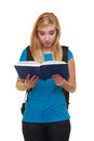 Casual girl female student with bag backpack reading book learn isolated Royalty Free Stock Photo