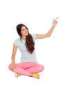 Casual girl sitting on the floor pointing something isolated white background Royalty Free Stock Image