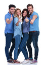 Casual group of people making the ok sign full body picture a young thumbs up hand on white background Stock Photos