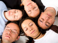 Casual group of people sleepin Royalty Free Stock Photos