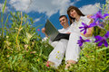 Casual happy couple on a laptop computer outdoors Royalty Free Stock Images