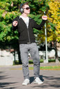 Casual man dancing in city park Stock Image