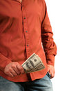 Casual man with few houndred dollars bills in the hand Royalty Free Stock Photography