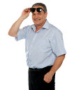 Casual man holding sunglasses over his head Royalty Free Stock Photography