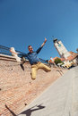 Casual man jumping in sibiu young the air the city of romania Royalty Free Stock Photos