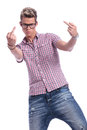 Casual man middle fingers young showing his two while looking angrily at the camera on white background Stock Photography