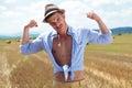 Casual man outdoor flexes his biceps Royalty Free Stock Photo