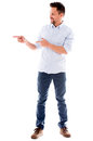 Casual man pointing to the side and smiling isolated over white background Royalty Free Stock Images