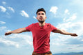 Casual man pretending to fly young outdoor with arms like wings preparing while looking away Royalty Free Stock Photos