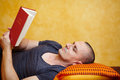 Casual man reading a book on the bed closeup shot Royalty Free Stock Photo