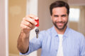 Casual man showing his house key in new home Royalty Free Stock Image