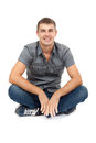 Casual man sitting in lotus position, smiling Royalty Free Stock Photos