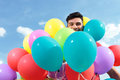 Casual man surrounded by baloons balloons Stock Images