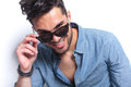 Casual man takes off sunglasses Royalty Free Stock Photo
