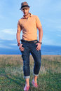 Casual man with thumbs in pockets, outdoor Royalty Free Stock Photo
