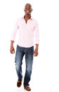 Casual man walking african american isolated over a white background Royalty Free Stock Photography