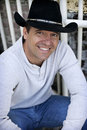 Casual man wearing cowboy hat Stock Image