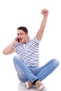 Casual man winning on the phone Royalty Free Stock Photos