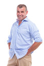 Casual middle aged man with hands in pockets senior posing his his while smiling for the camera isolated on white background Stock Image