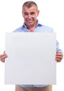Casual middle aged man holding banner senior an empty while smiling for the camera isolated on white background Stock Photo