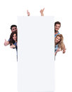 Casual people behind a big banner making the ok sign smiling thumbs up onwhite background Stock Photography