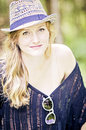 Casual pretty young woman portrait of an attractive smiling with long blonde hair wearing hat Royalty Free Stock Image