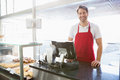 Casual server posing behind the counter Royalty Free Stock Photo