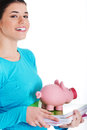 Casual student woman holding workbook and piggy bank isolated on white Royalty Free Stock Photos