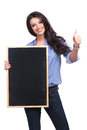 Casual woman with blackboard shows thumb up young holding a and showing the sign while smiling for the camera on white background Royalty Free Stock Photo