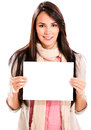 Casual woman holding banner ad isolated over white Royalty Free Stock Images