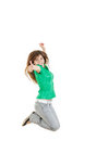 Casual woman jumping happy and free in full body pretty or girl with thumb up of joy excited isolated on white background green Royalty Free Stock Photo