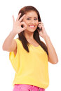 Casual woman with phone and ok gesture Royalty Free Stock Images